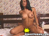 Tgirl rides hard cock on her bed