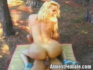 Blonde Tranny in a bikini gets analized